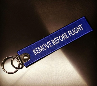Брелок Remove Before Flight синий