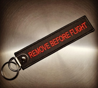 Брелок Remove Before Flight чёрный